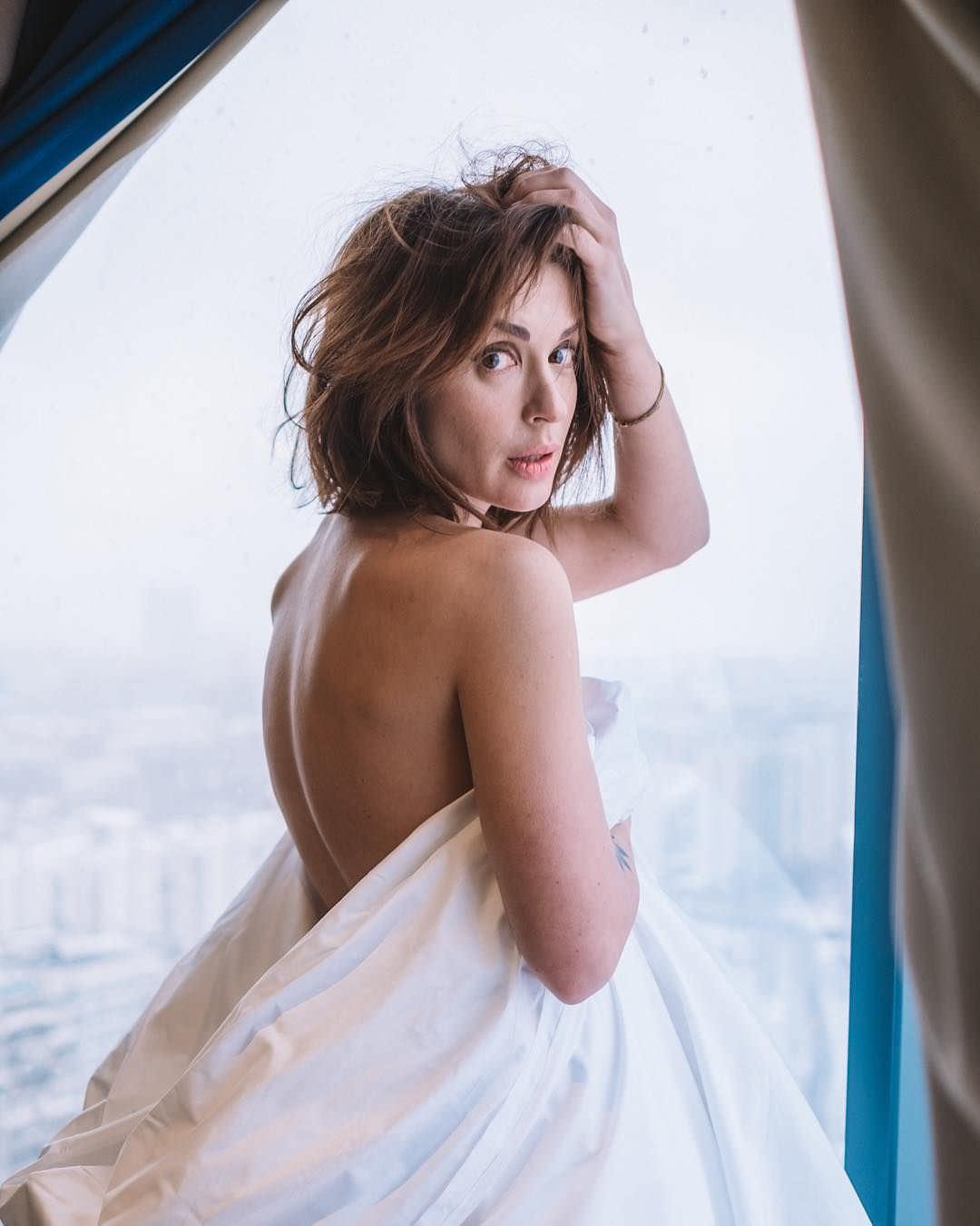 Ирина Муромцева фото со спины